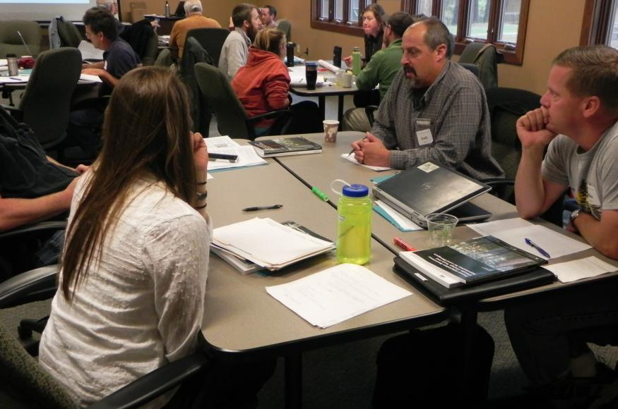 DNR foresters Mike Lichter (far right) and Scott Burns (second from right) discuss adaptation ideas with co-workers at a workshop.